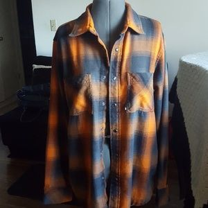 The North Face Plaid Snap Front Closure Shirt.